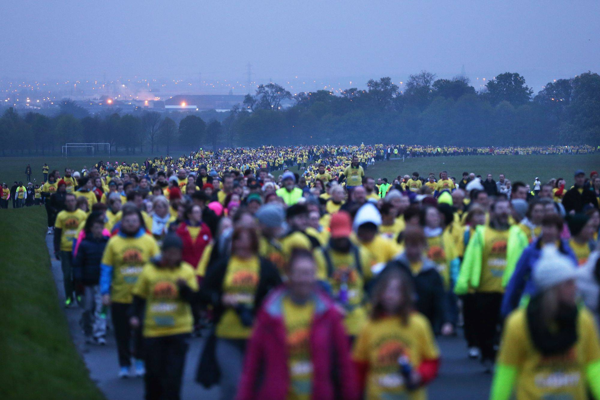 09/05/2015. An estimated 100,000 people turned out for dawn walks for Pieta House's annual Darkness Into Light fundraising and awareness event. The 5km walk, supported by Electric Ireland, got underway at 4.15am on Saturday morning, 9th May in 80 locations in Ireland and across the world. Families, friends, children, colleagues and even pets turned out in locations from Wicklow to Washington to walk in solidarity for suicide prevention. Melbourne and Perth were amongst the first cities to set off, with an estimated 4000 people walking in Australia. They were closely followed by London, Manchester and Glasgow where almost 1500 people walked in cities across the UK. The walks finished up in New York, Toronto, and Chicago amongst others where it's estimated 1700 people participated in the walk. Pictured are people this morning in Dublin's Phoenix Park. Photography: Sasko Lazarov/Photocall Ireland